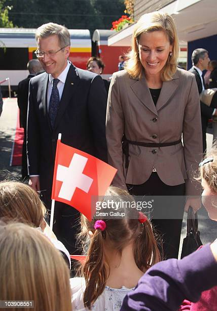 Children waving German and Swiss flags greet German President Christian Wulff and his wife First Lady Bettina Wulff upon the Wulffs' arrival by train...