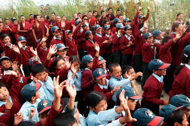 Children waving hands in shey, Leh, Ladakh, Jammu and Kashmir, India