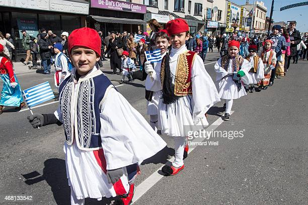 TORONTO ON MARCH 29 Children wear costumes as they march in the Greek Independence Day parade