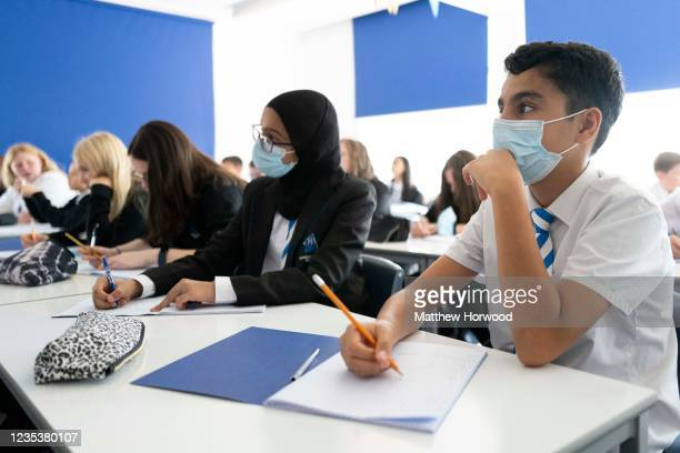 Children wear face masks during a maths lesson at Llanishen High School on September 20, 2021 in Cardiff, Wales. All children aged 12 to 15 across...