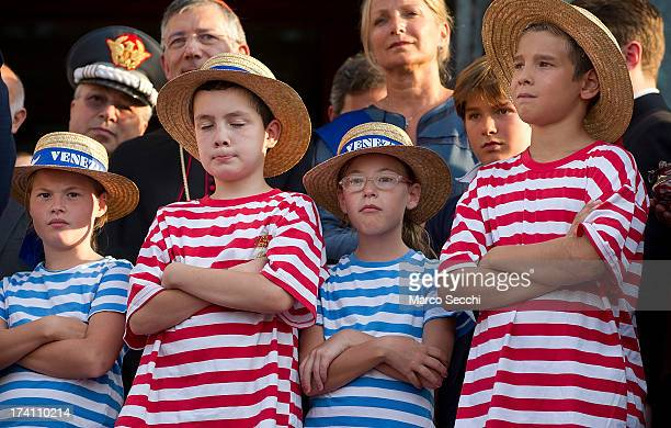 Children wear gondolier shirts at the opening of the Redentore Celebrations on July 20 2013 in Venice Italy Redentore is one of the most loved...