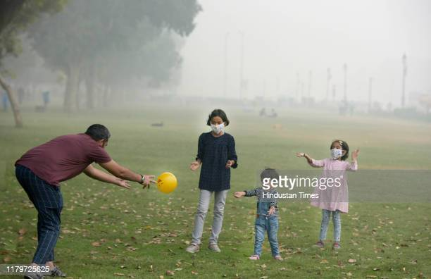 Children wear mask as they play at India Gate Lawns on November 3 2019 in New Delhi India The air quality index hit 473 at 9 am according to Central...