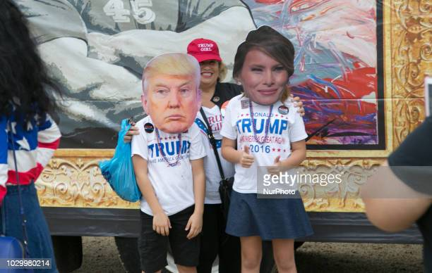 Children wear masks of Donald and Melania Trump during the Mother of All Rallies at the National Mall in Washington DC on September 8 2018