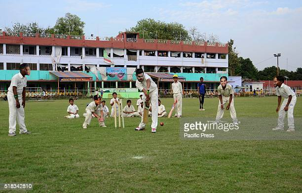 Children wear masks of Indian Cricket players during their practice for cricket on the eve of Semifinal cricket match of T20 world Cup at Madan Mohan...