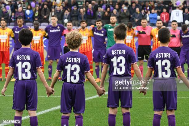 Children wear N°13 jerseys as players and supporters pay tribute to late Fiorentina's captain Davide Astori on March 11 2018 during the Italian Serie...
