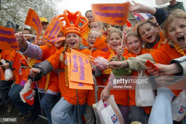 Children wear the national color while waiting for Dutch Queen Beatrix Queen's Day celebrations to begin April 30 2002 in Meppel The Netherlands...