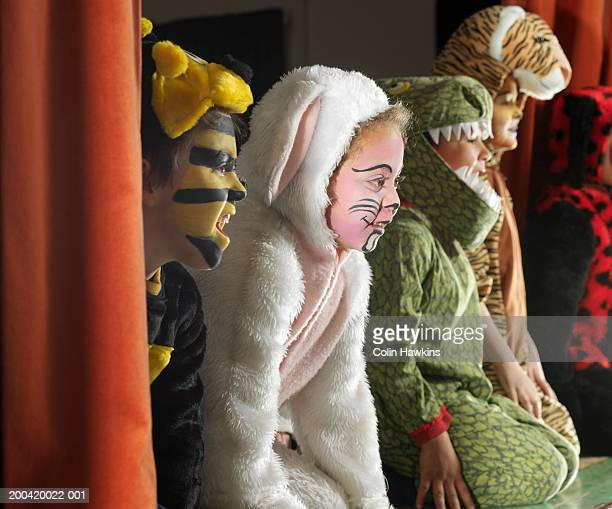 Children (5-7) wearing animal costumes on stage, close-up