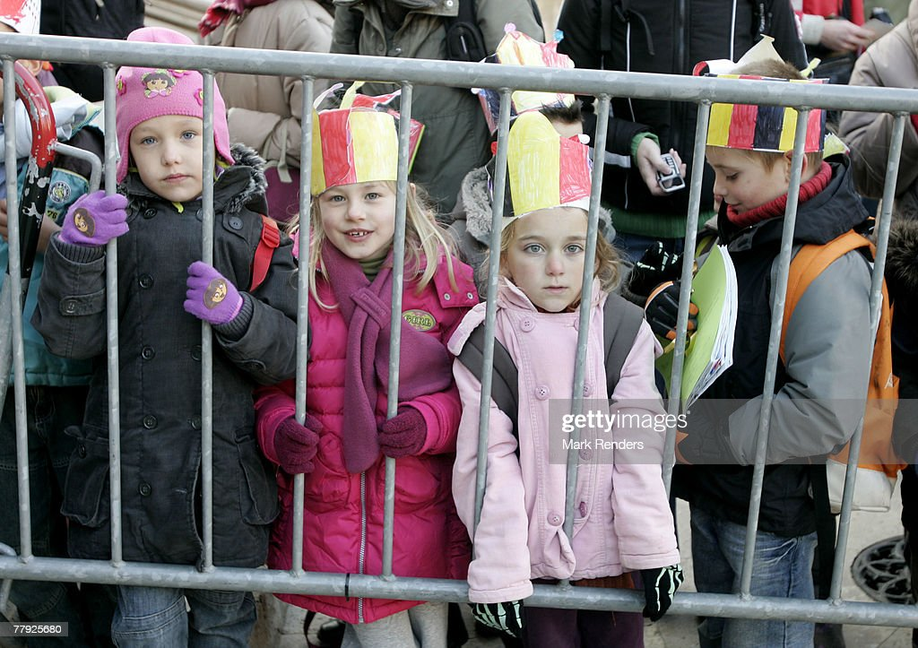 Children wearing Belgian Hats wait for the Royalties in front of St G?dule Cathedral before the Te Deum , on Kings Day on November 15, 2007 in Brussels, Belgium.