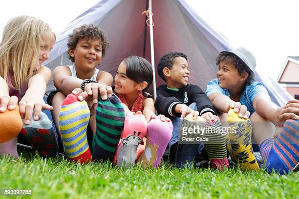 children wearing coloured socks outside tent - sock stock pictures, royalty-free photos & images