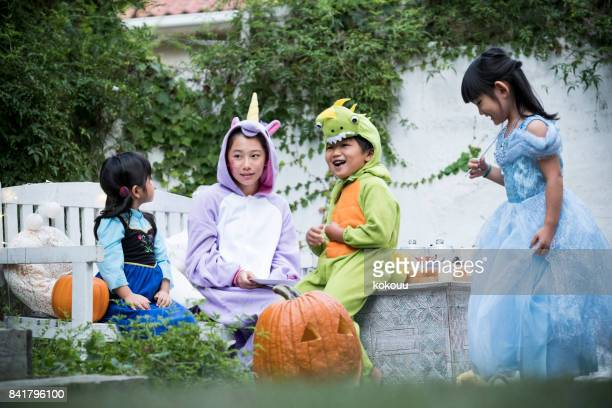 Children wearing costumes and playing outside.