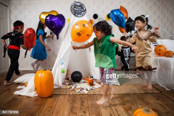 Children wearing costumes are playing in the children's room.
