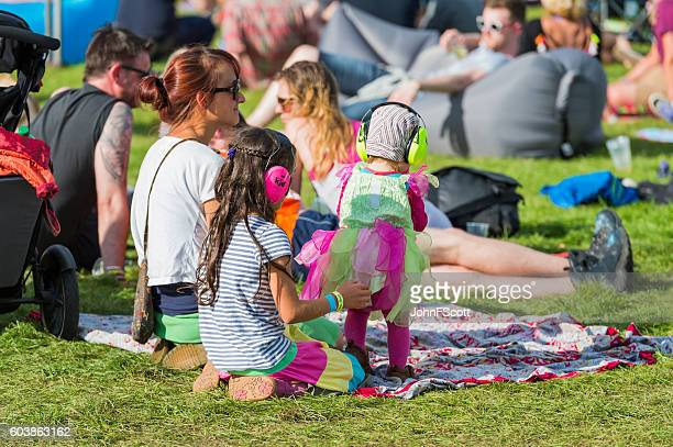Children wearing ear defenders at a music festival in Scotland