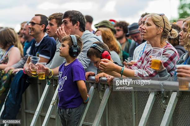 Children wearing ear defenders at a music festival