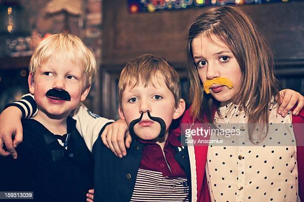 Children wearing fake moustaches