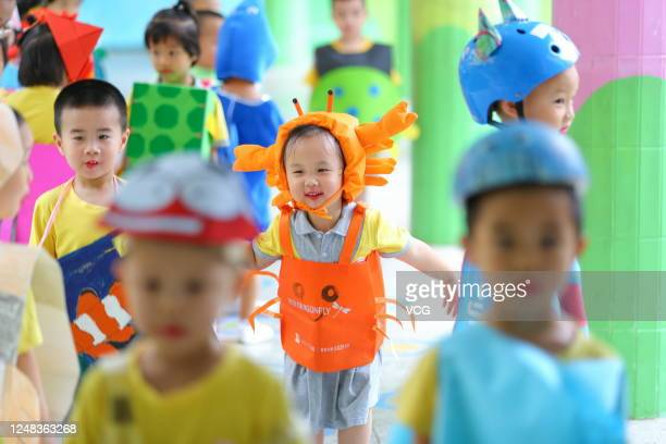 Children wearing marine animals shaped costumes take part in a fashion show at a kindergarten on the World Oceans Day on June 8 2020 in Haikou Hainan...