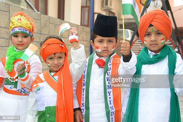 Children wearing orange and green theme traditional dress during the Republic Day It honors the date on which the Constitution of India came into...