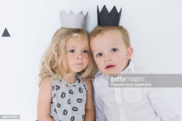 children wearing paper crowns - crown close up stock pictures, royalty-free photos & images