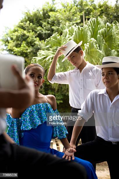 Children wearing Plena traditional attire, outdoors