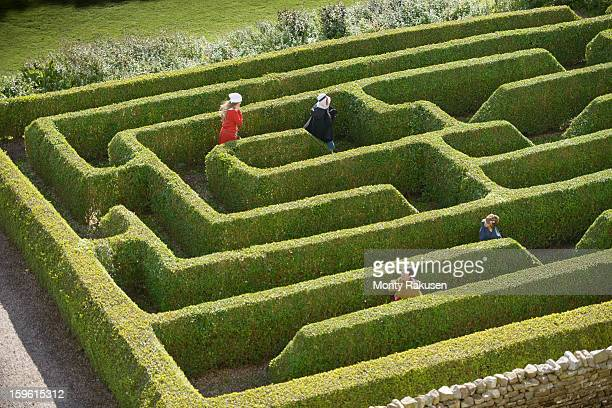 Children wearing traditional costume in maze at Bolton Castle, 14th century Grade 1 listed building, Scheduled Ancient Monument