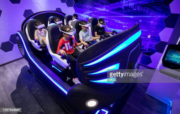 Children wearing VR headsets watch videos at a science and technology museum during their summer vacation on July 22 2020 in Hohhot Inner Mongolia...