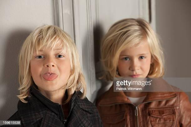 Children wearing winter coats indoors