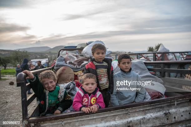 Children who are forced and brought to Afrin to be used as human shields by PKK/KCK/PYDYPG and Daesh terror groups are seen on a pickup truck with...