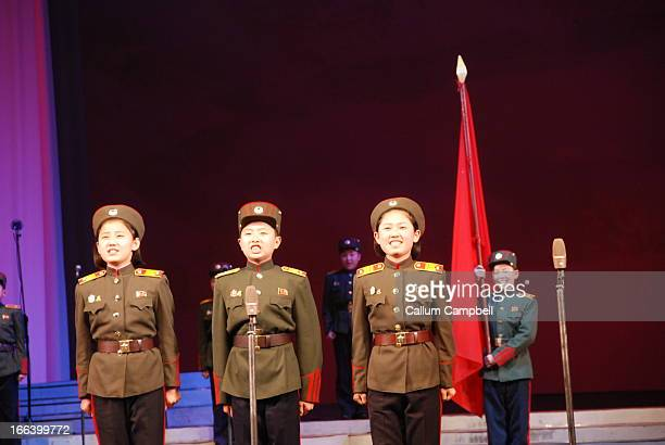 Children who have been orphaned , sing a song dedicating themselves to the Korean State, and proclaiming the DPRK and its leaders as their real...