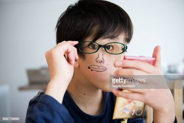 children who paint on face and play - idiots stock pictures, royalty-free photos & images