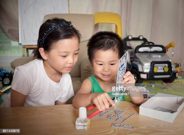 children who work together to build a model - model building stock photos and pictures