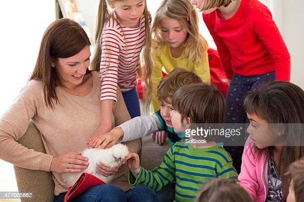 Children With A Pet Chicken