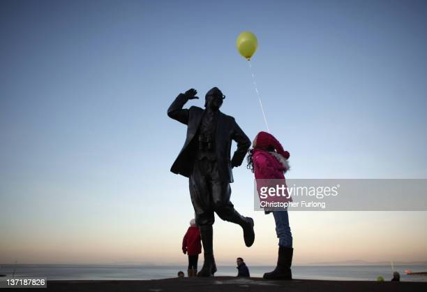 Children with balloons play beside the statue of British comedy legend Eric Morecambe on January 16 2012 in Morecambe England According to scientists...
