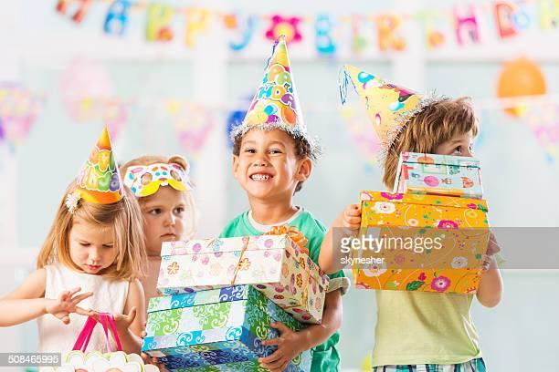Children with birthday presents.