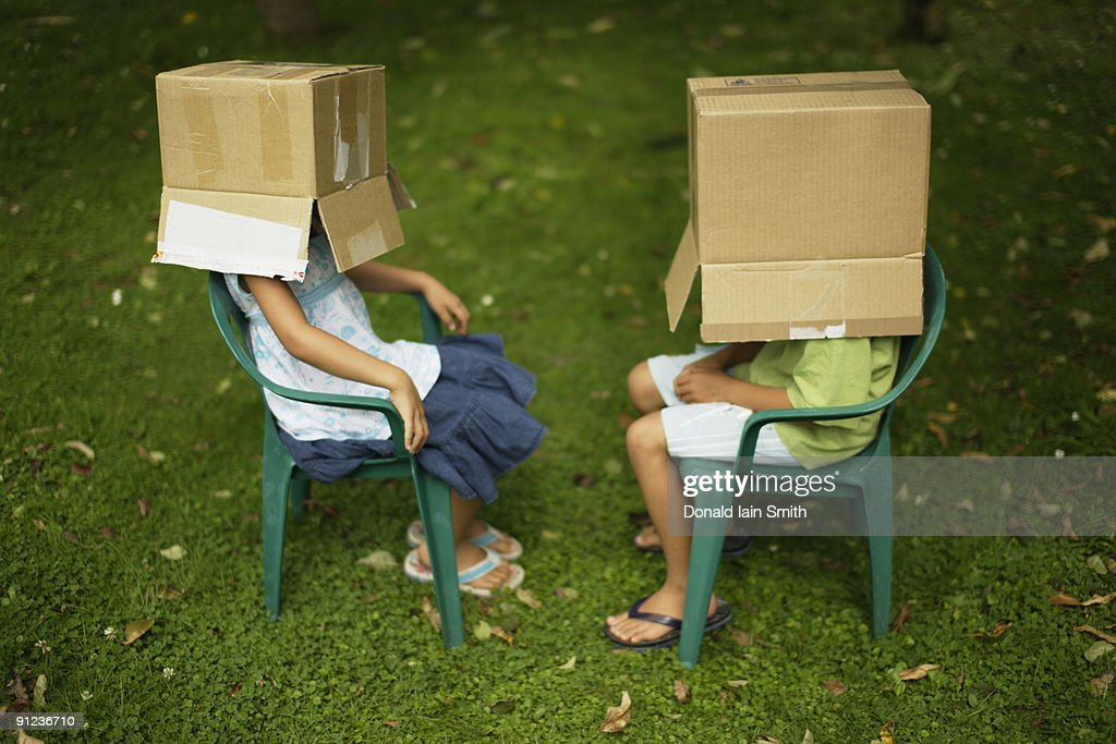 Children with box on head : Stock Photo