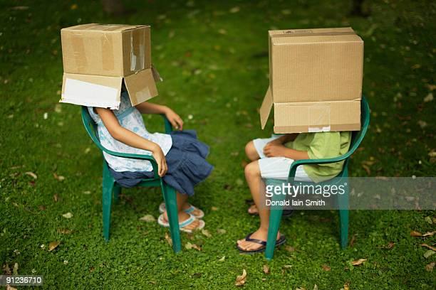 Children with box on head