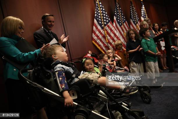 Children with complex medical conditions attend a press conference held by Democratic senators at the US Capitol to highlight potentially...