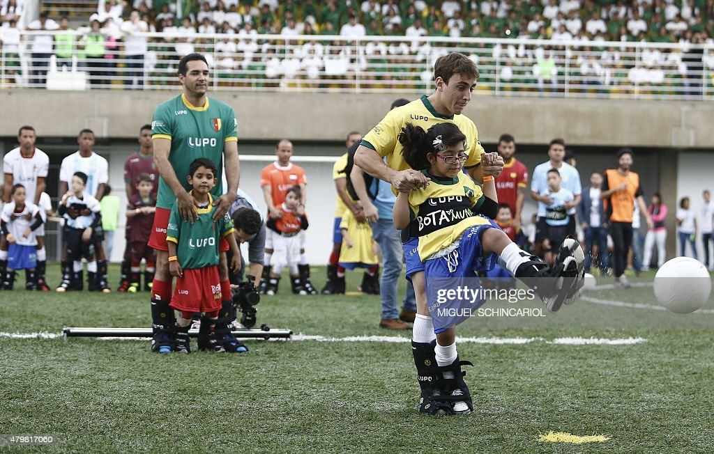 Children with different capabilities and professional athletes take part in the project 'Bota do Mundo' (World's Boot) of the Neymar Project Institute, in Praia Grande, Sao Paulo, Brazil on July 07, 2015. The institute is a sports complex for needy children and their families. AFP PHOTO / Miguel SCHINCARIOL