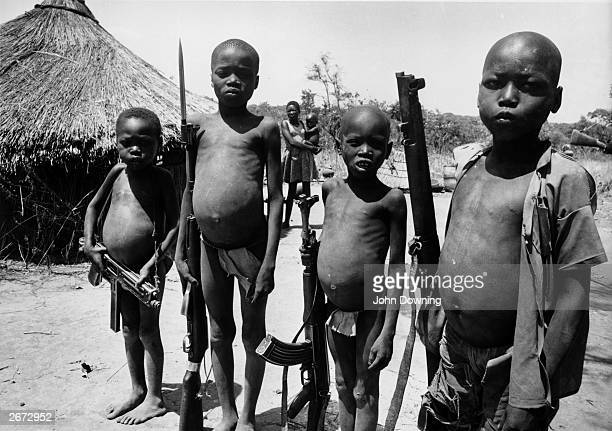 Children with guns during the civil war in southern Sudan