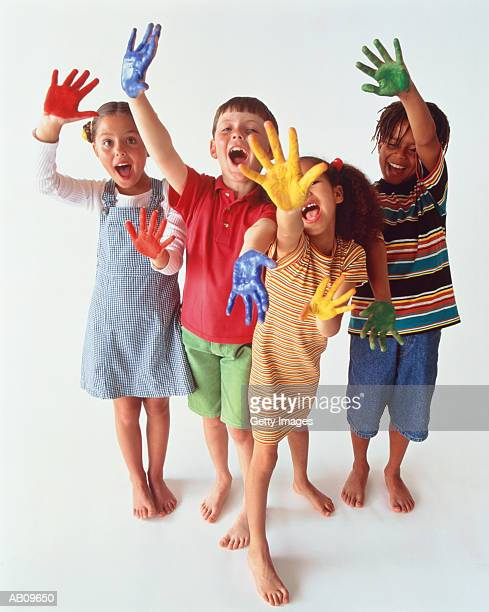 Children with hands covered in paint