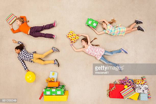 Children with heaps of birthday presents
