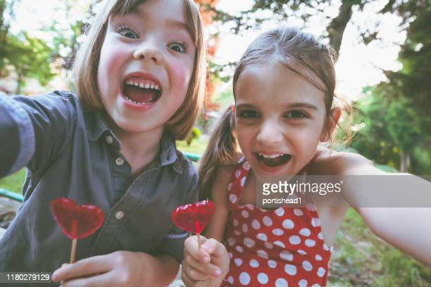 children with lollipops having fun and making  selfie - new generation stock pictures, royalty-free photos & images