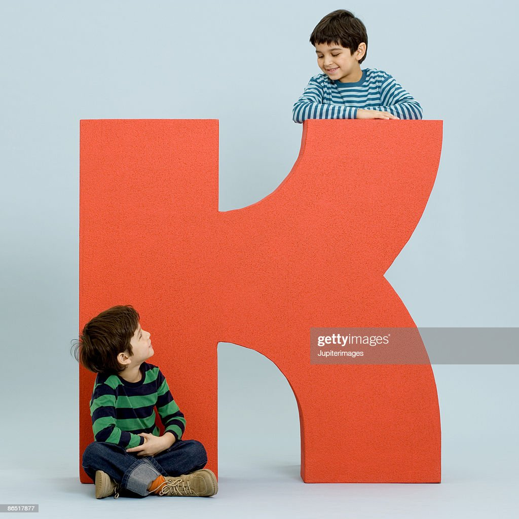 Children with oversized letter : Stock Photo