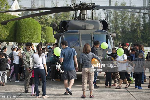 Children with parents in queue for visit inside a military helicopter during the National Children's Day event inside a military base in Bangkok...
