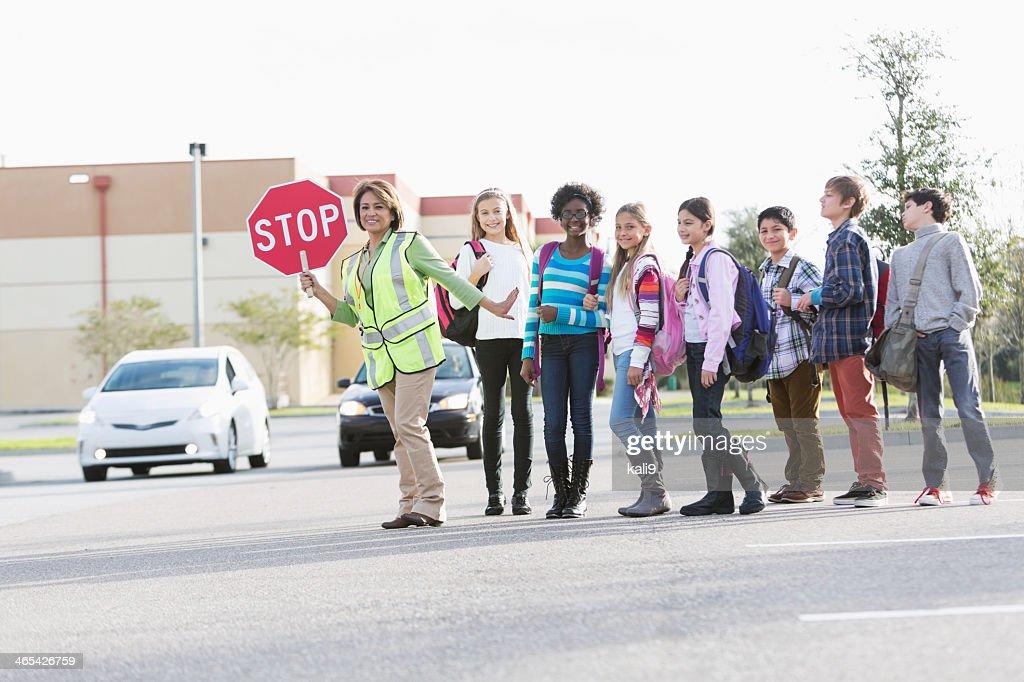 Children with school crossing guard : Stock Photo