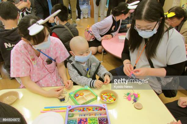 Children with serious illnesses play in a kids room at the National Center for Global Health and Medicine's hospital in Tokyo on Nov 10 2017 The Waku...