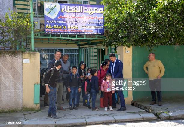 Children with special needs attend a rehabilitation centre in Iraq's northern city of Mosul on March 4, 2020. - Mosul's few health centres treating...