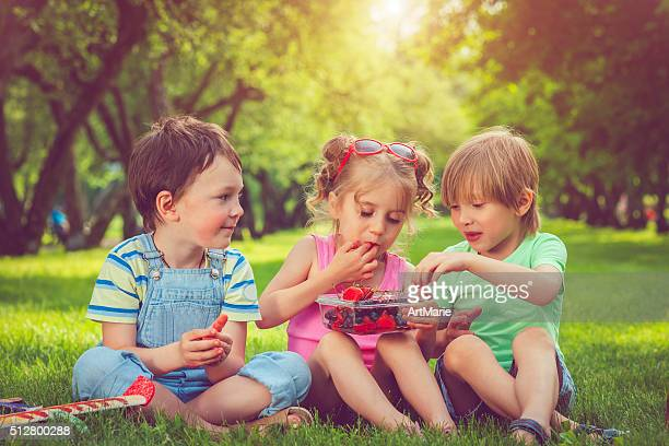 Children with summer berries