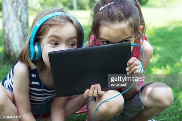 children with tablet - digital native stock pictures, royalty-free photos & images