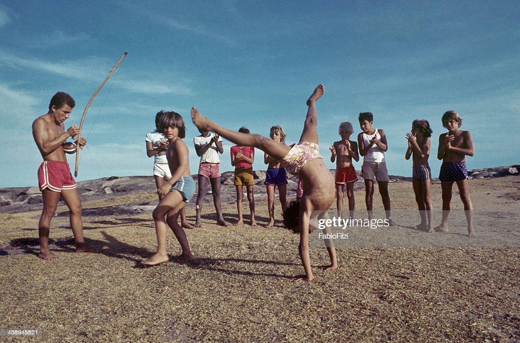 children with teacher, practicing capoeira. : Stock Photo