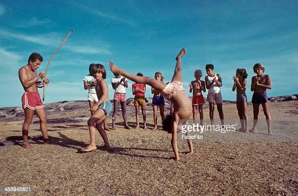 children with teacher, practicing capoeira.