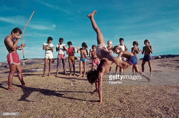 children with teacher, practicing capoeira. - fabio filzi stock photos and pictures